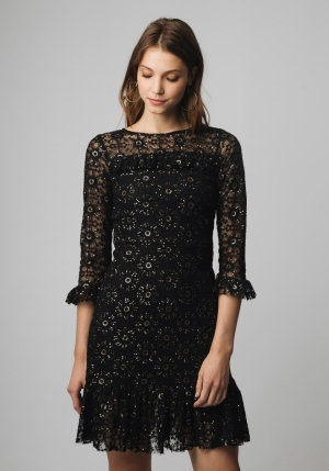 vestido negro lentejuelas volante bajo